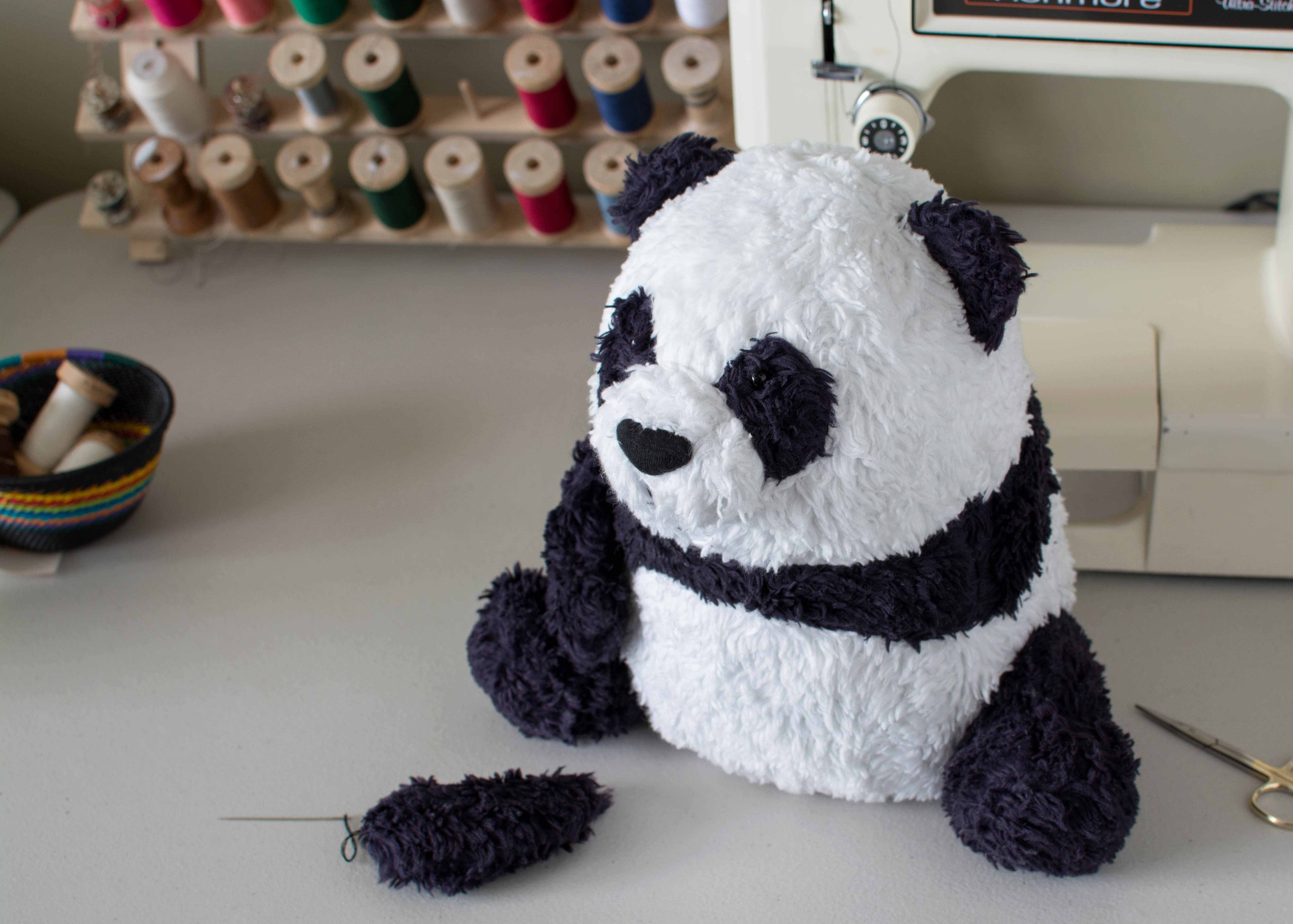 OOAK Organic Panda in progress sewing on the arms fluffmonger